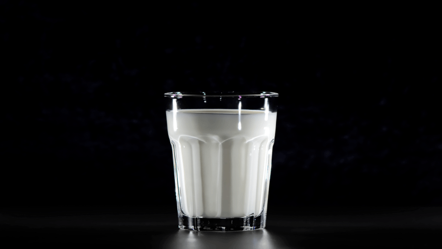 Milk In Glass With Black Background