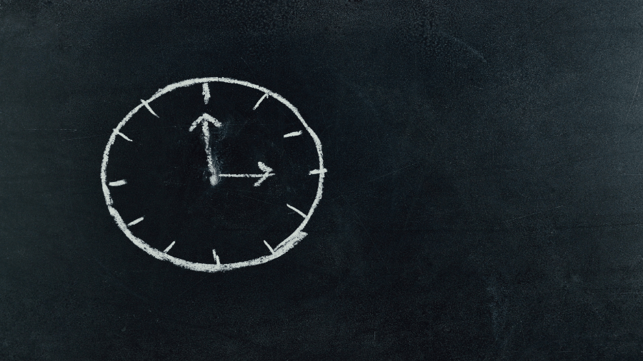 Analog Clock Drawn On Chalkboard