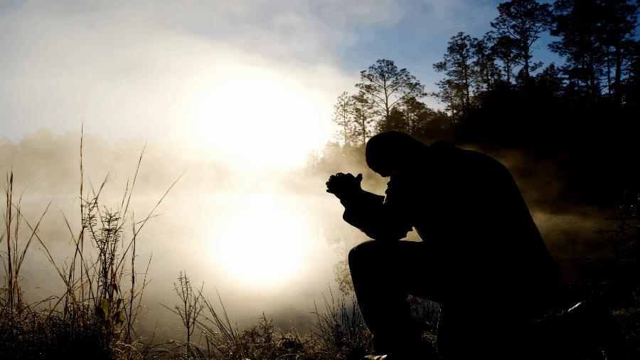 Praying Near Water And Light