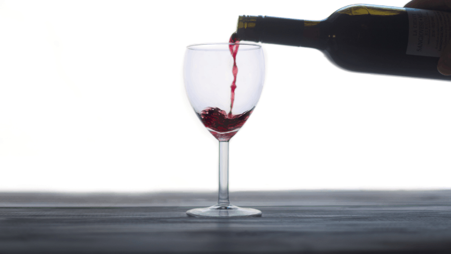 Wine Poured In Glass 900x506