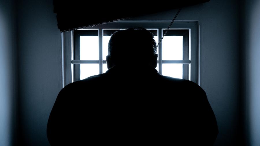 Man In Dark Near Window With Light 900x506