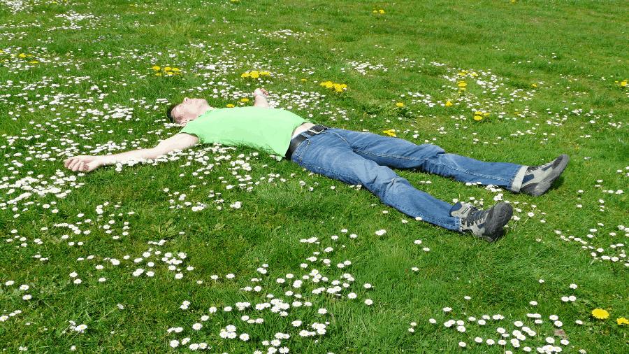 Man Resting In Green Grass 900x506