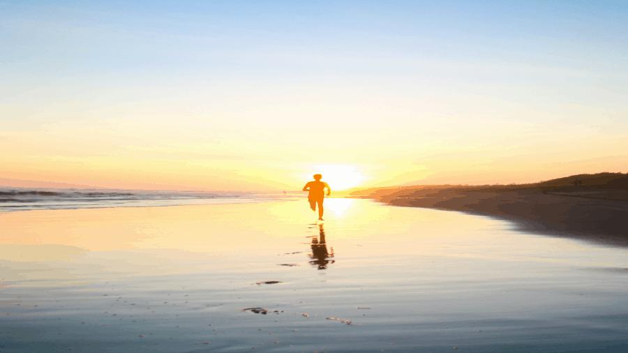 Son Running On Beach In Sun 900x506