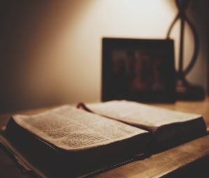 Bible On Desk With Lamp 300x256
